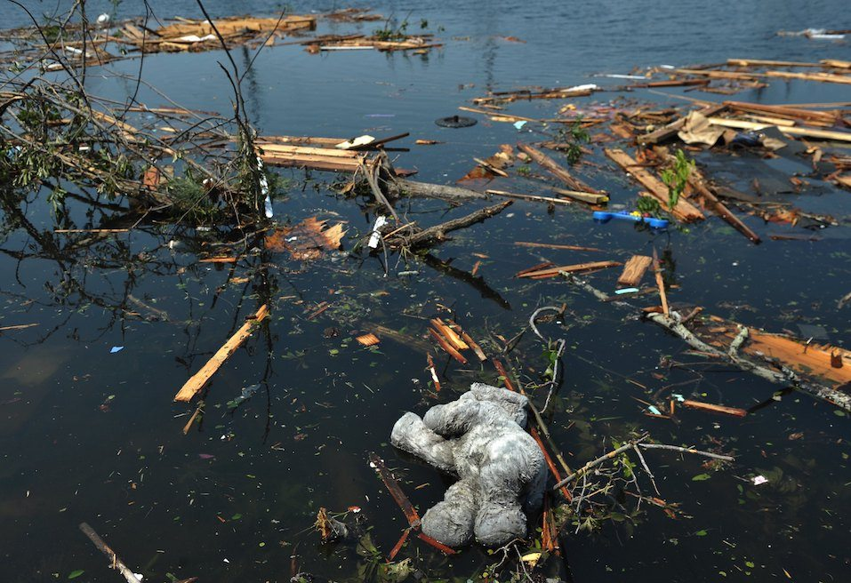 A child's toy floats in the water in the tornado stricken Forest Lake neighbourhood
