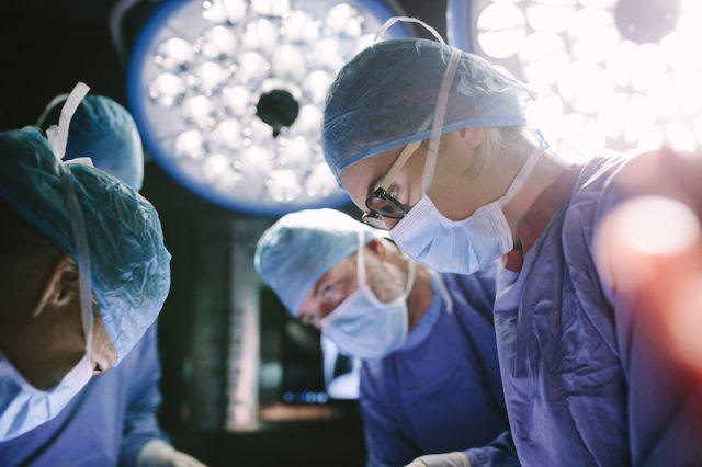 A team of surgeons working on a patient.