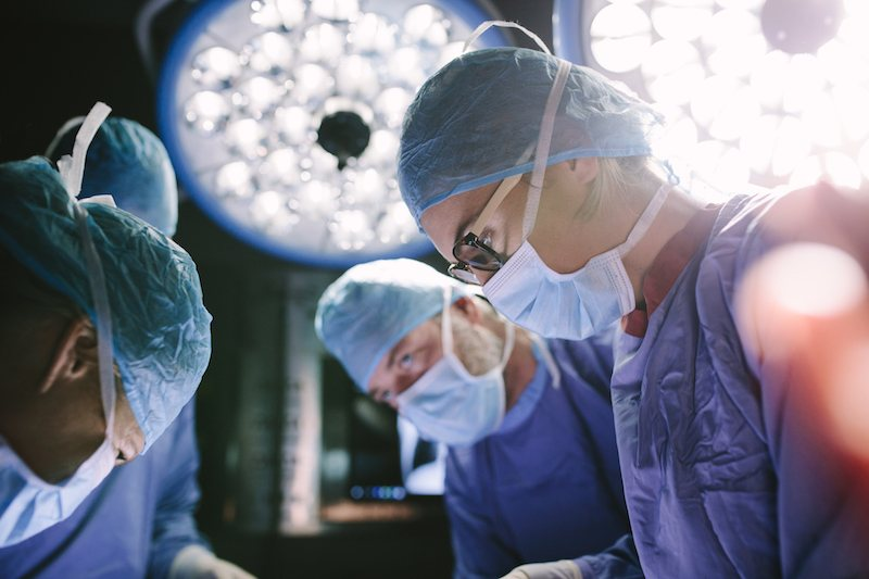 A surgeon and associates in action.