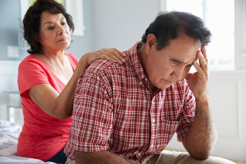 Wife Comforting Senior Husband
