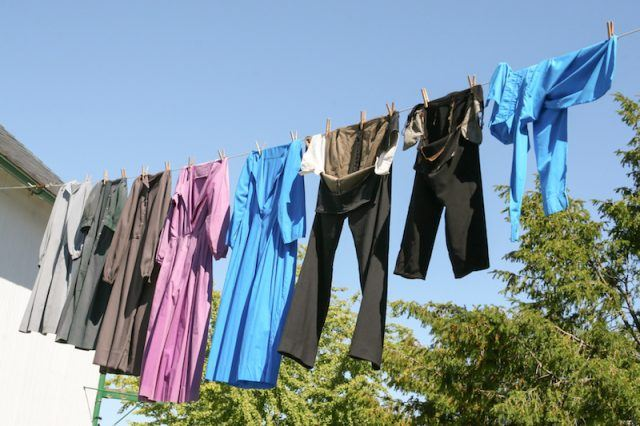 Clothing seen drying on a clothesline.