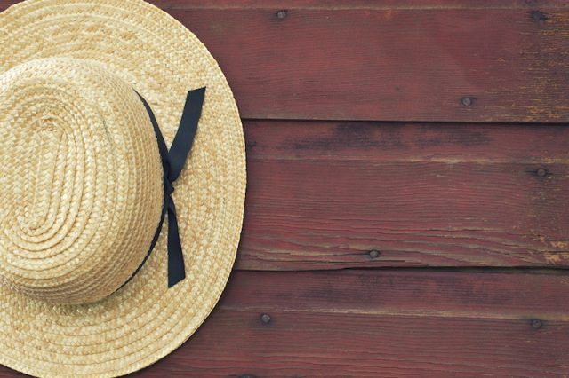 A hat resting on a wooden board.