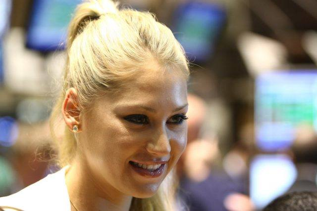 Anna smiling while posing for a photo at the New York Stock Exchange