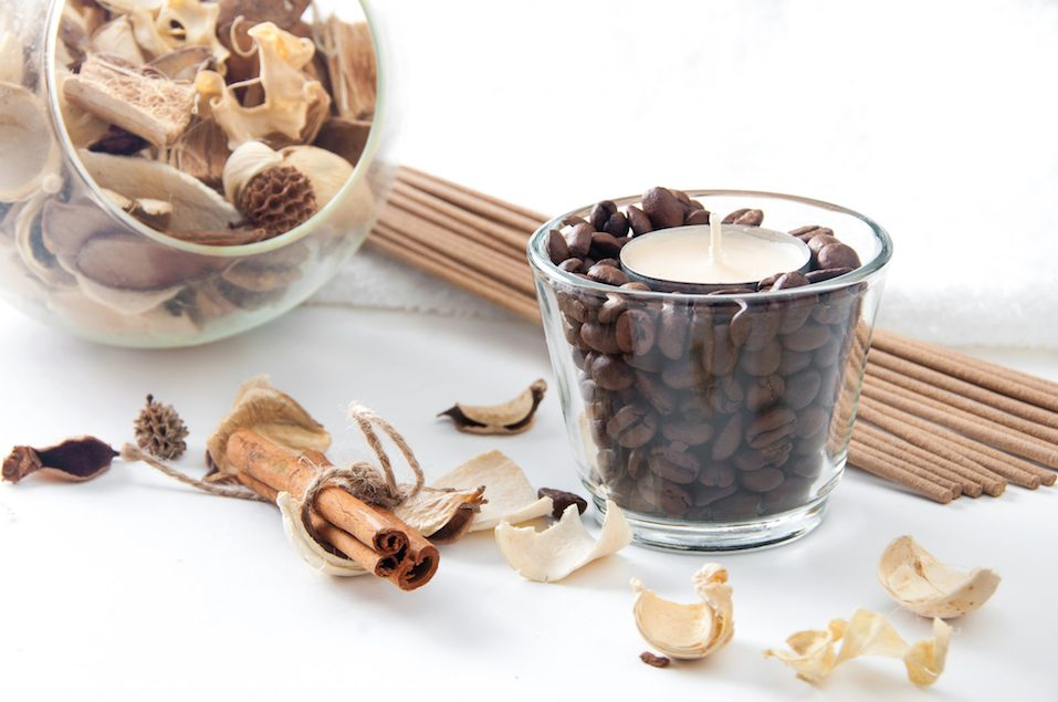 Aroma candle in the glass with coffee beans