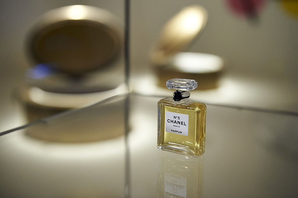 A miniature bottle of Chanel No. 5 perfume forms