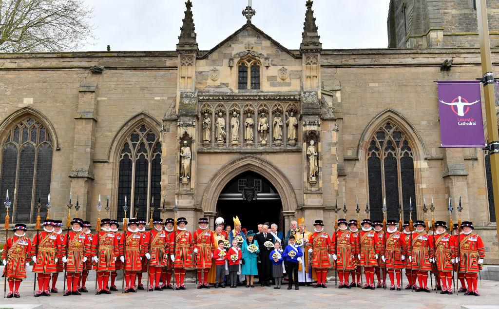 Britain's Queen Elizabeth II and Britain's Prince Philip, Duke of Edinburgh pose with Yeoman of the Guard following the Royal Maundy service