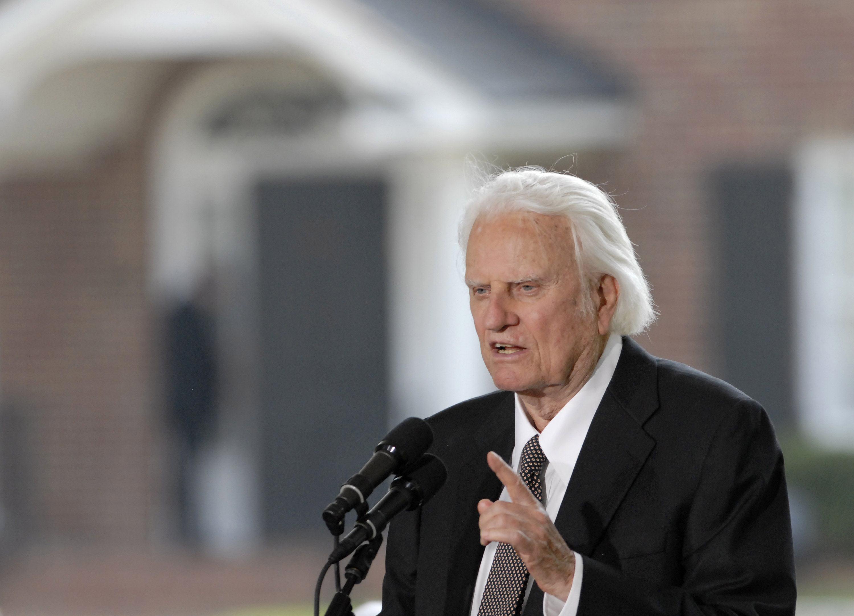 Evangelist Billy Graham speaks into microphone