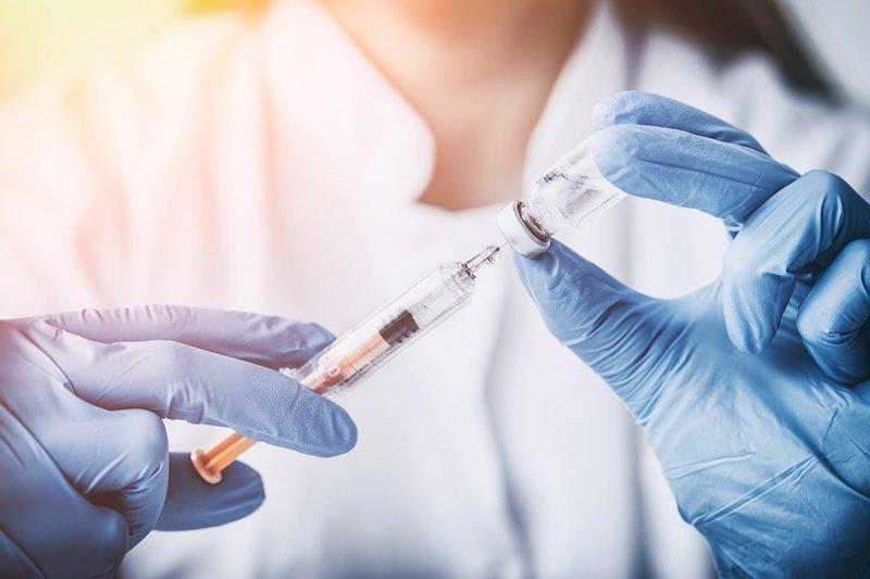 A doctor preparing a vaccine