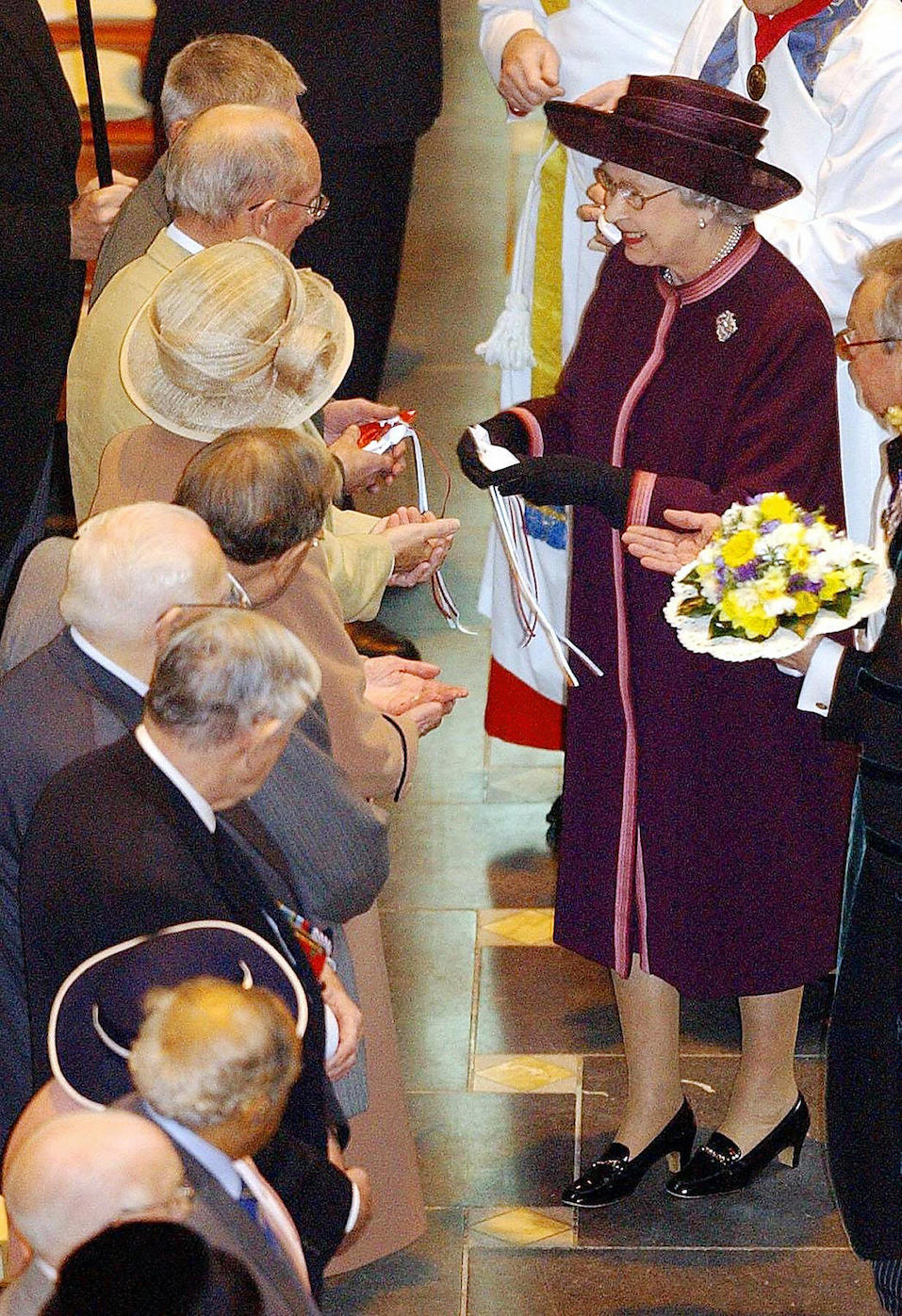 Britain's Queen Elizabeth II hands out maundy money during the Royal Maundy Service