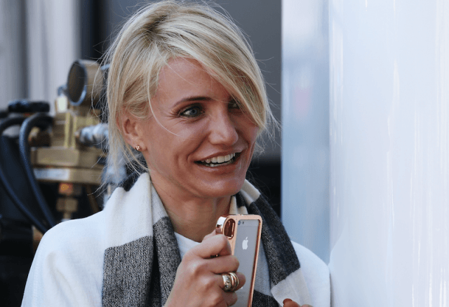 Cameron Diaz smiles while wearing her engagement ring.