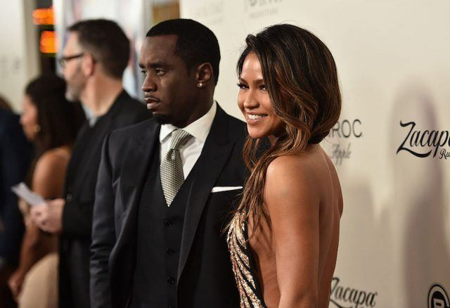 Sean Combs and Cassie Ventura posing on a red carpet.