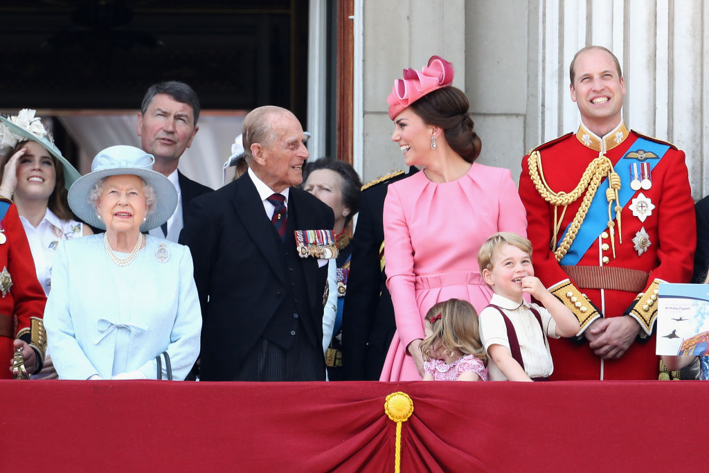 Queen Elizabeth II, Prince Philip, Duke of Edinburgh, Catherine, Duchess of Cambridge, Princess Charlotte of Cambridge, Prince George of Cambridge and Prince William, Duke of Cambridge look out from the balcony of Buckingham Palace during the Trooping the Colour parade.