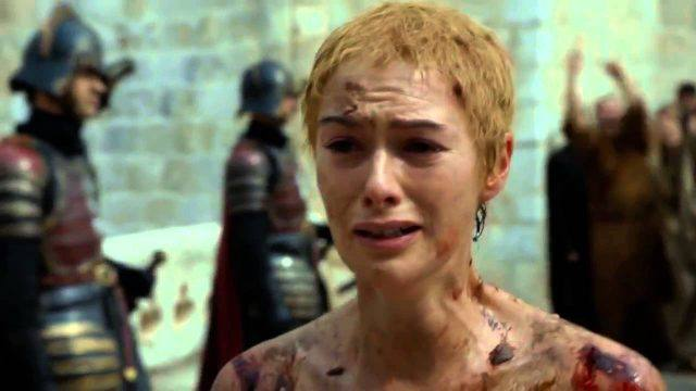 Cersei stands in front of guards and a crowd.