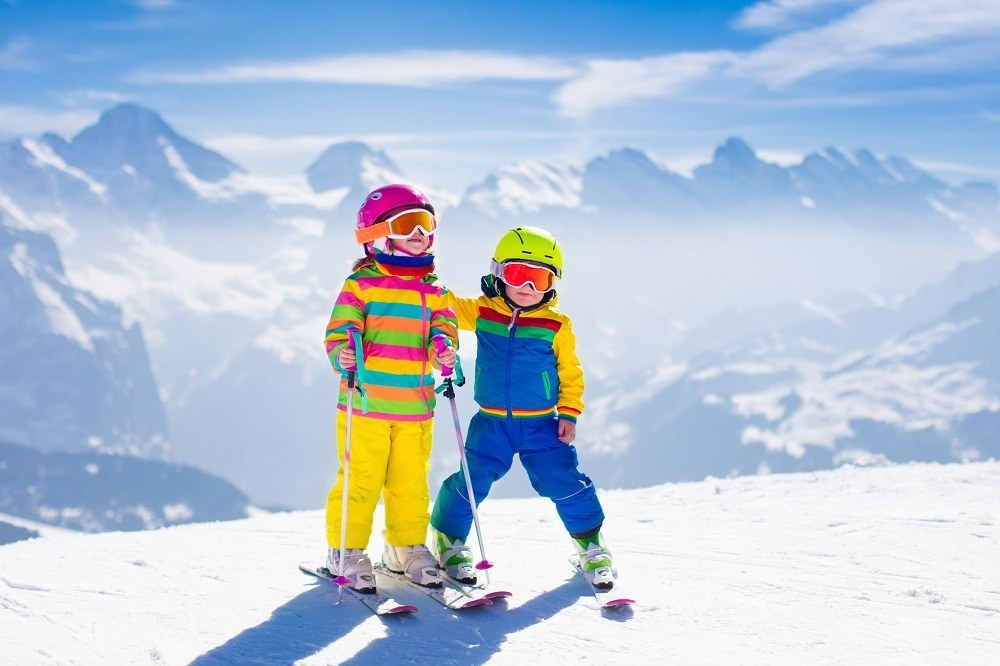 Kids skiing in mountains