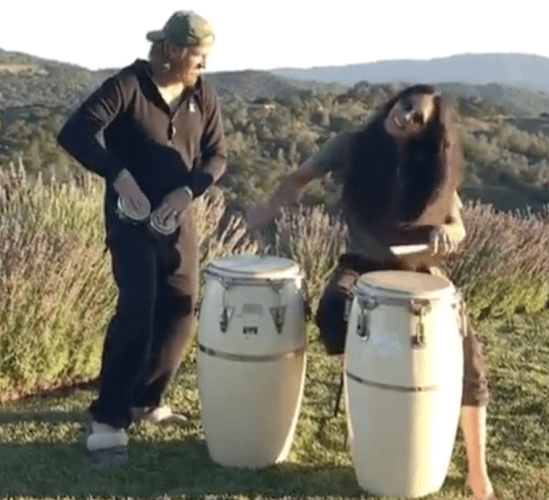 Chip and Joanna Gaines perform on drums.