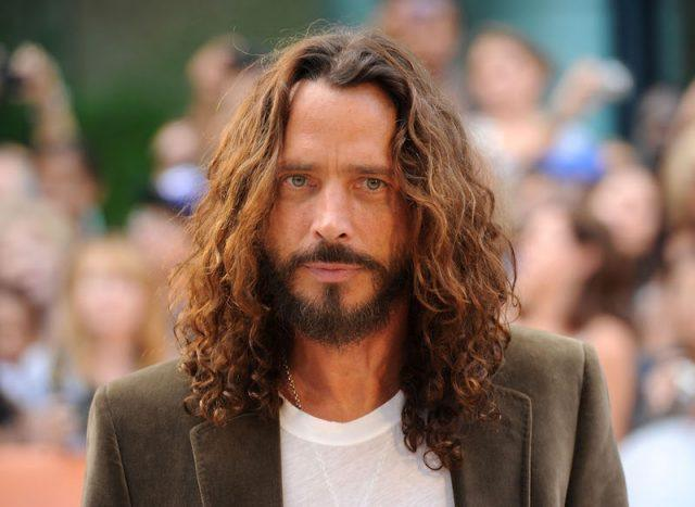 Chris Cornell poses in front of a crowd.