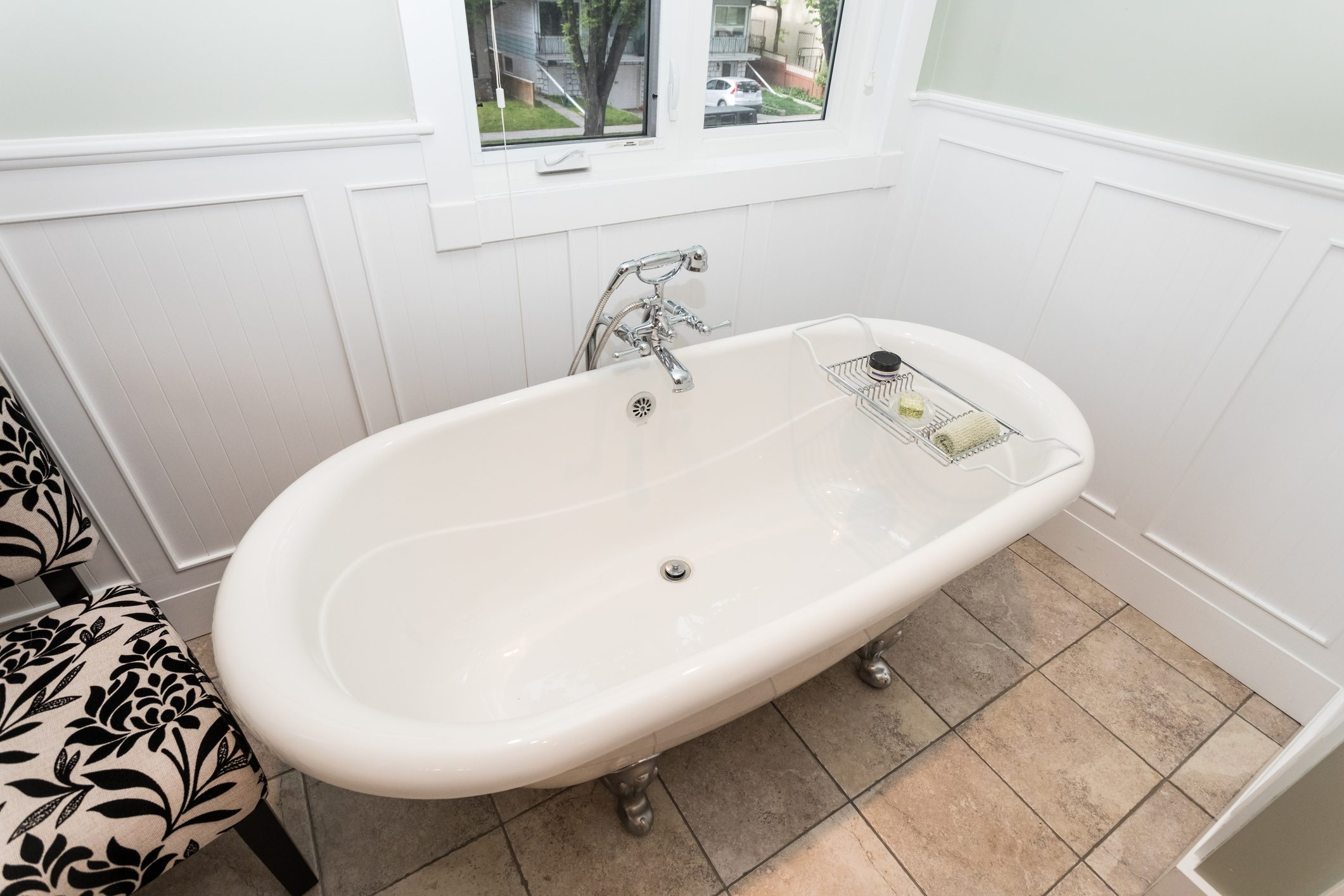 Stand alone clawfoot bathtub in clean bathroom