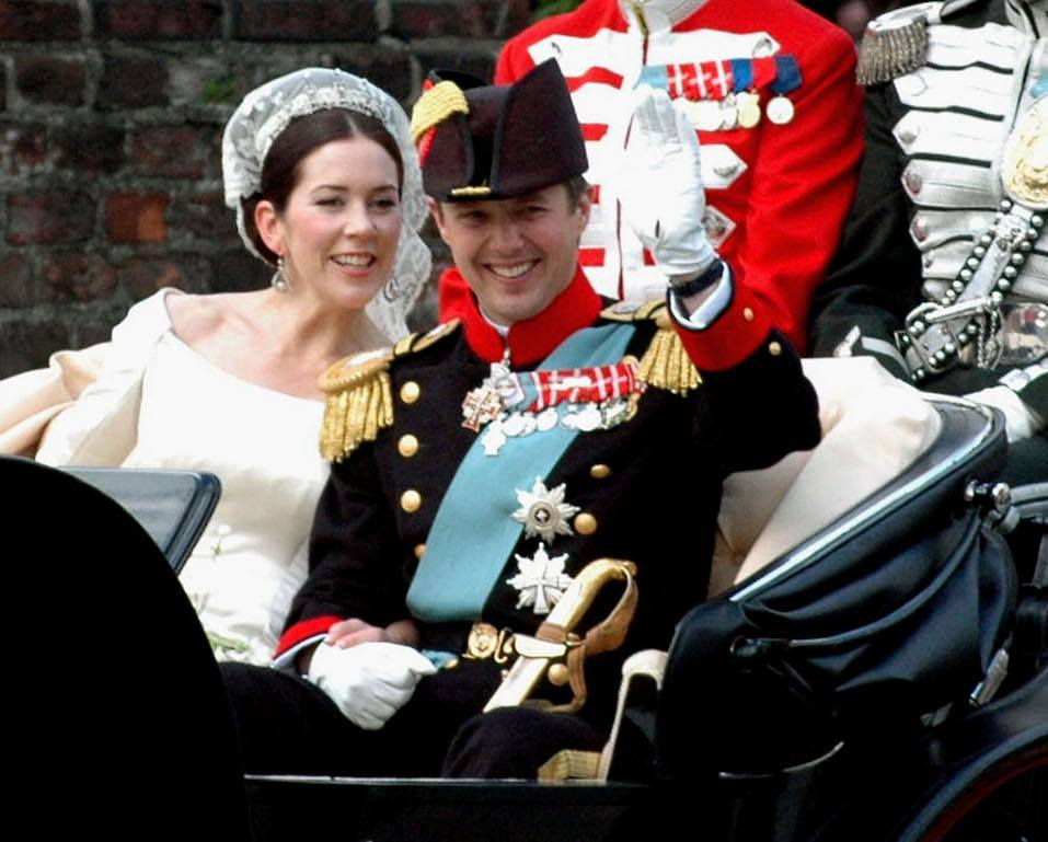 Danish Crown Prince Frederik and his bride Mary wave from their carriage during a procession
