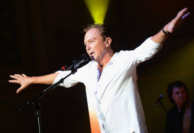 David Cassidy performing in front of a microphone.