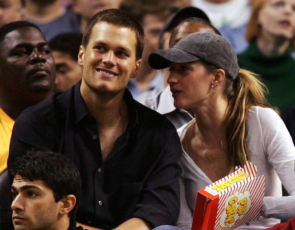 Tom Brady of the New England Patriots and Gisele Bündchen watch as the Detroit Pistons play against the Boston Celtics
