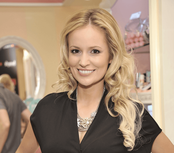 Emily Maynard posing and smiling at an event.