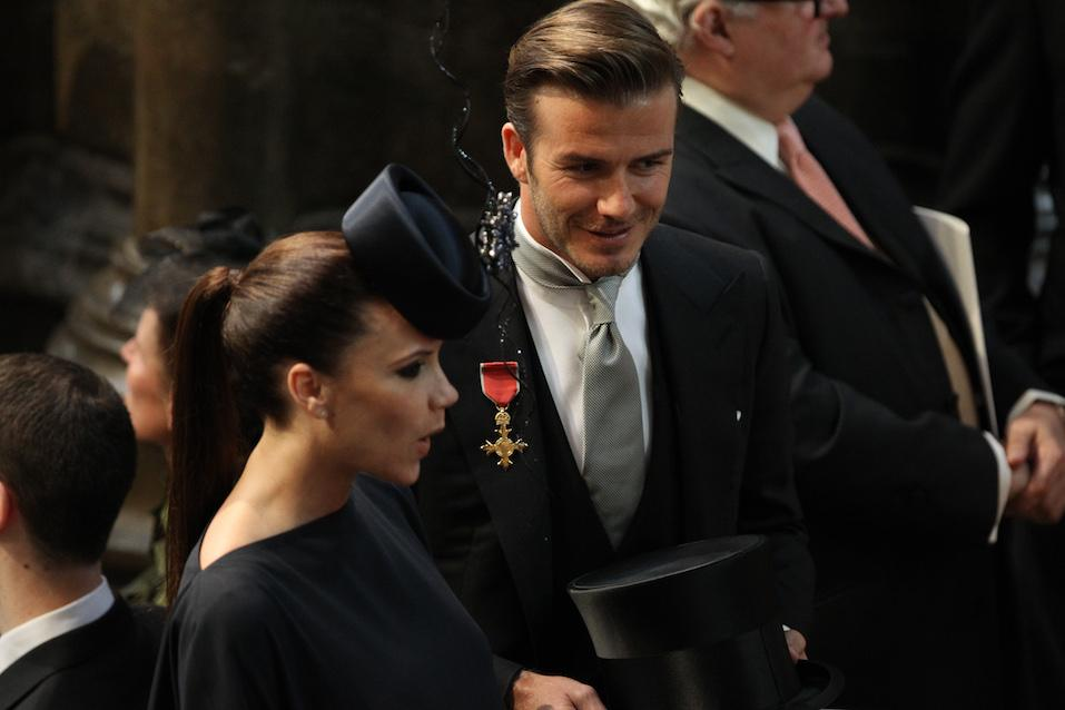 David Beckham and British designer Victoria Beckham attend the wedding service for Britain's Prince William and Kate Middleton