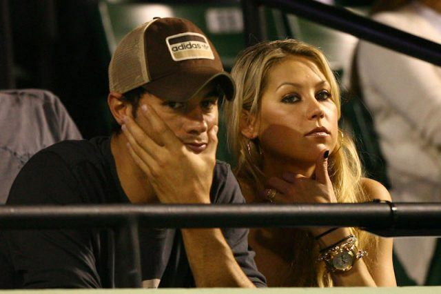 The couple watches a tennis match.