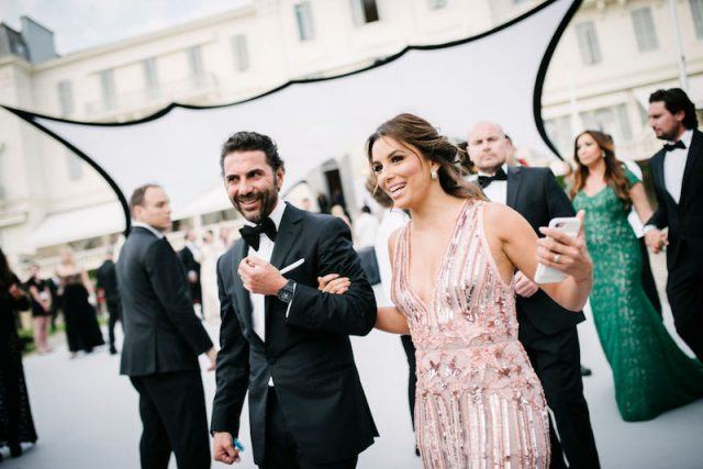 Eva Longoria and José 'Pepe' Bastón walk together at a formal party.