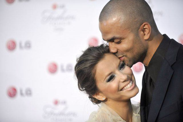 Eva Longoria is being kissed by Tony Parker.
