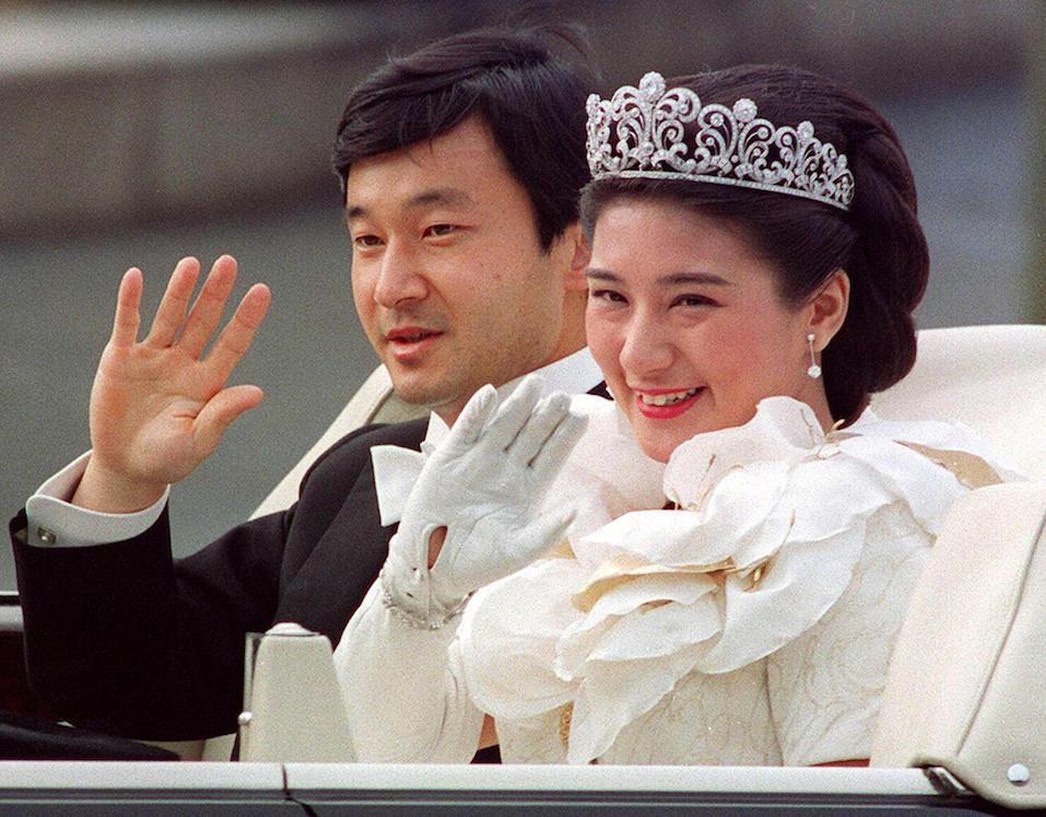 Japanese Crown Prince Naruhito (L) and Crown Princess Masako (R) waving to people during the parade