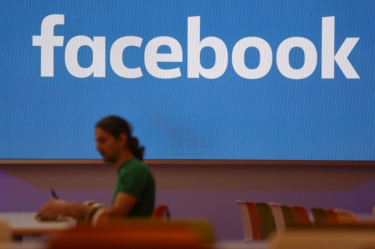 Employee eats lunch at Facebook