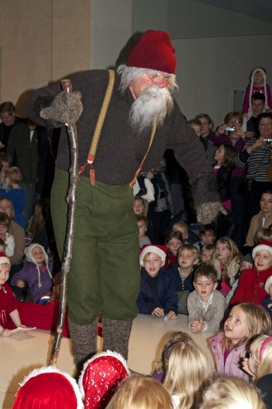 one of the yule lads entertains children in iceland