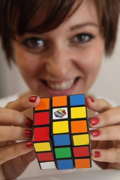 a woman models a rubix cube