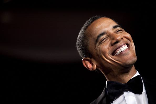 barack obama laughing in a black bow tie tuxedo