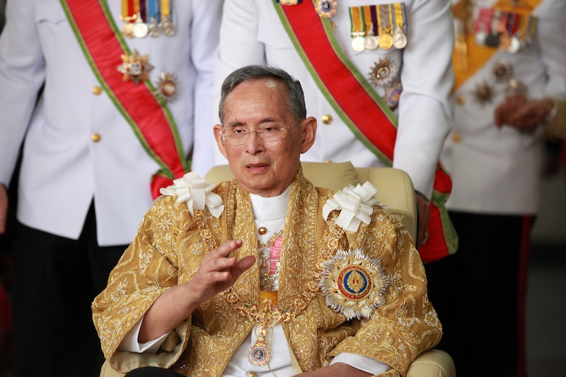 Thailand's King Bhumibol Adulyadej waves