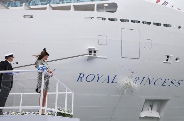 Kate Middleton christens a ship.