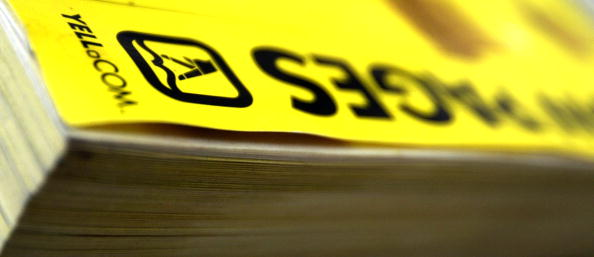 a close-up of the edge of a yellow pages phone book