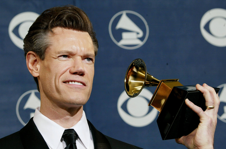 Randy Travis holding a Grammy