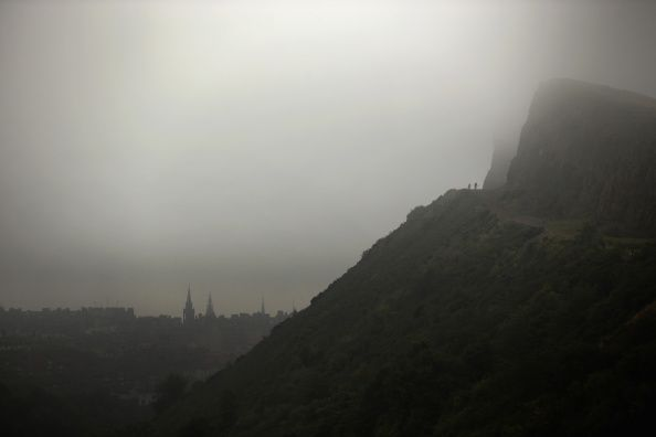 mist surrounding arthur's seat and edinburgh