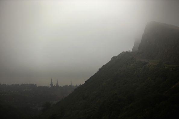 mist surrounding arthur's seat and edinburgh