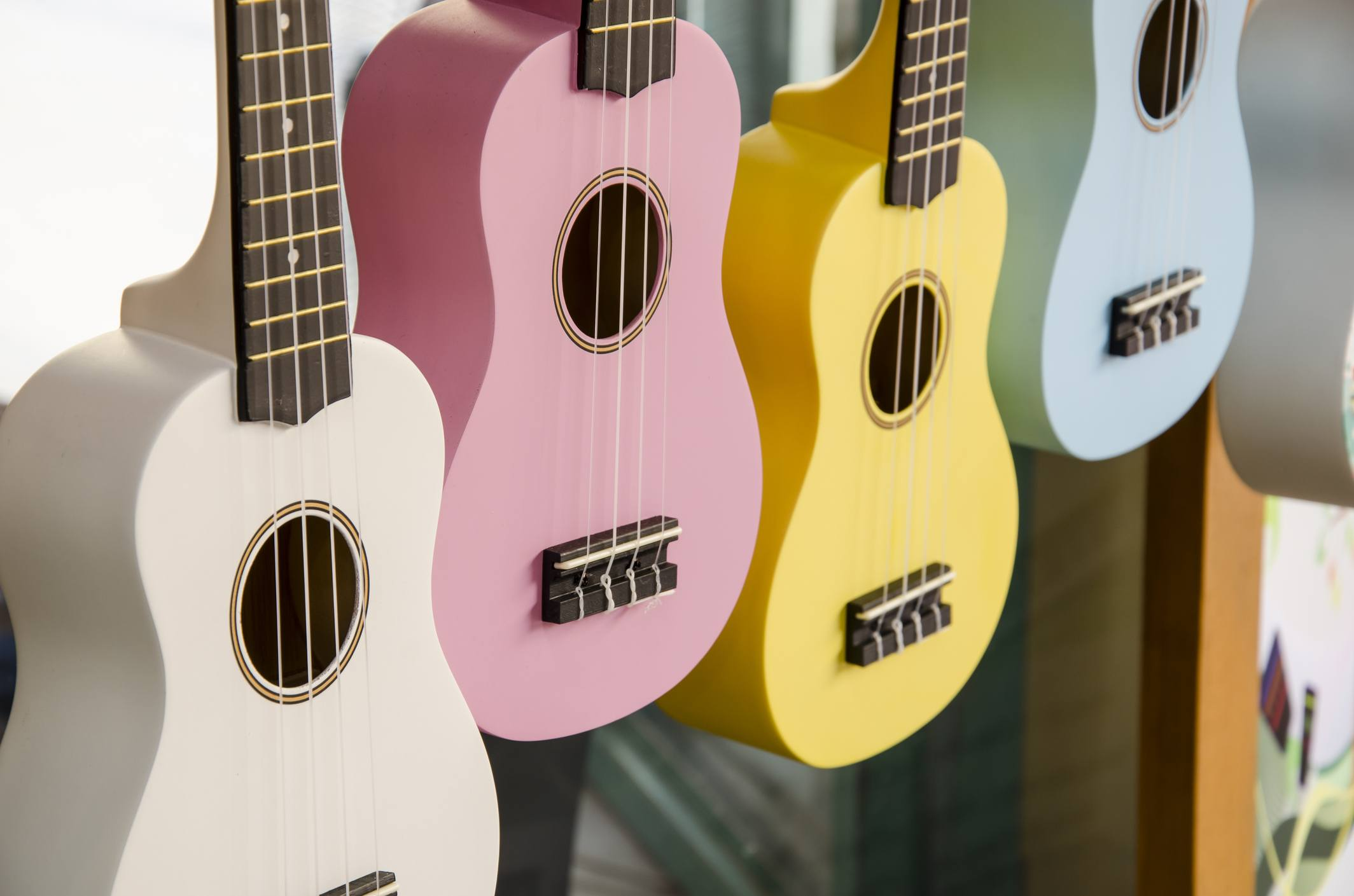 colorful ukuleles hanging