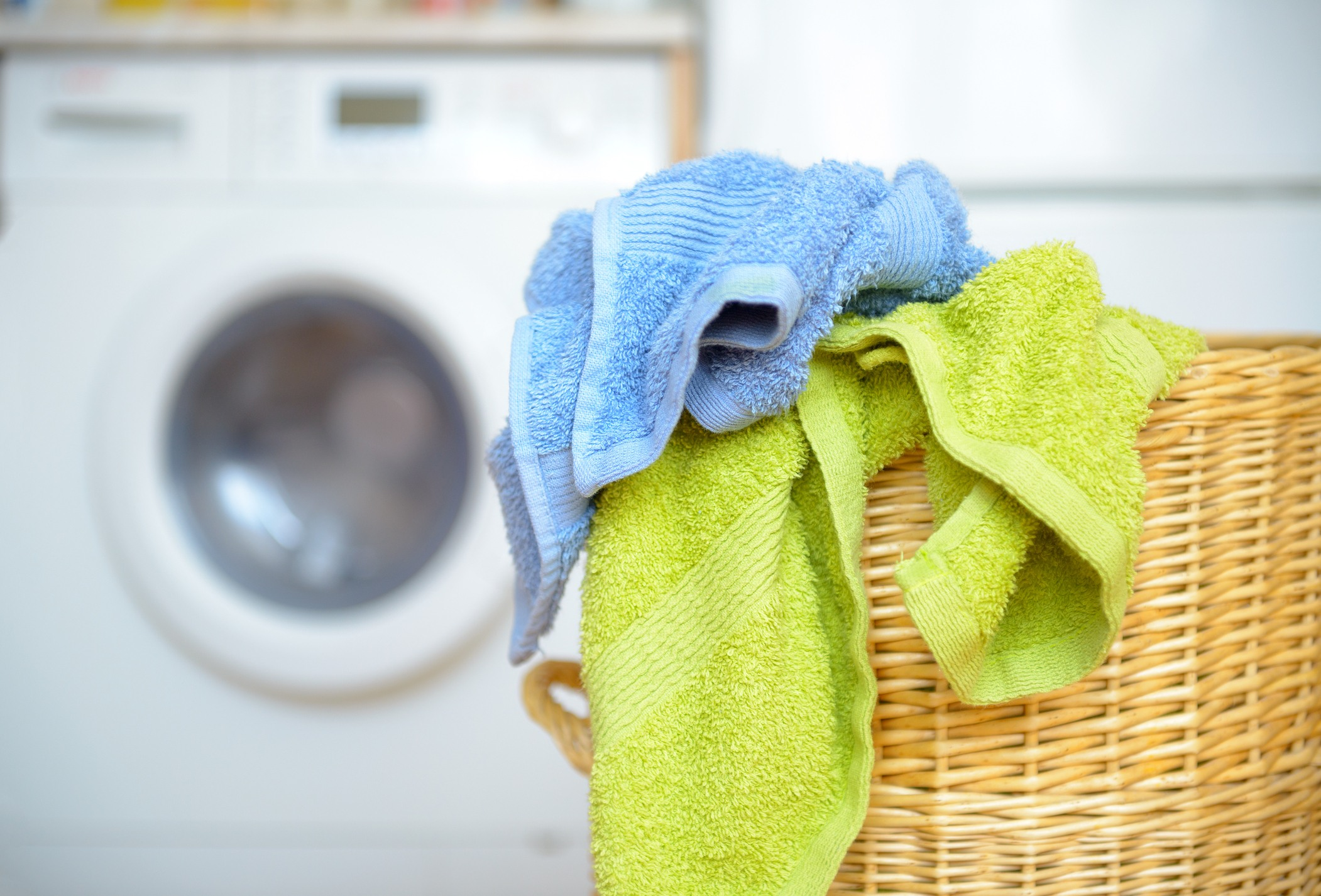towels in basket with washing machine in background