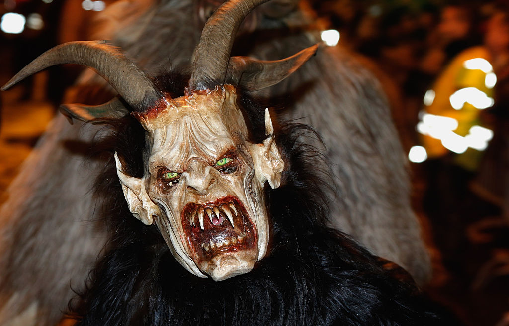 a krampus in Austria participates in the krampus parade