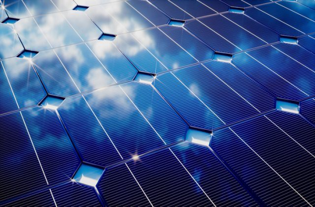 Photovoltaic with cloudy sky reflection.