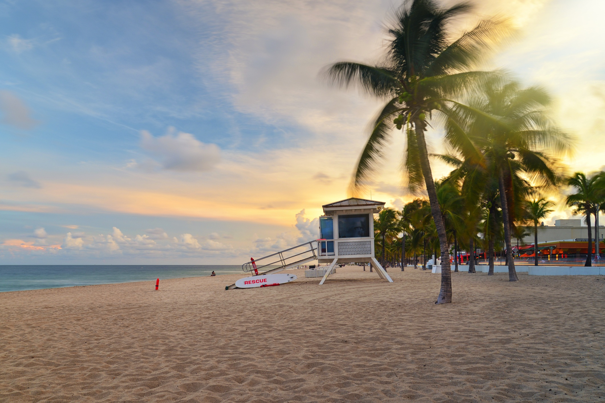 Sunset at Sunrise Beach in Ft.Lauderdale with palm trees and beach entry feature.