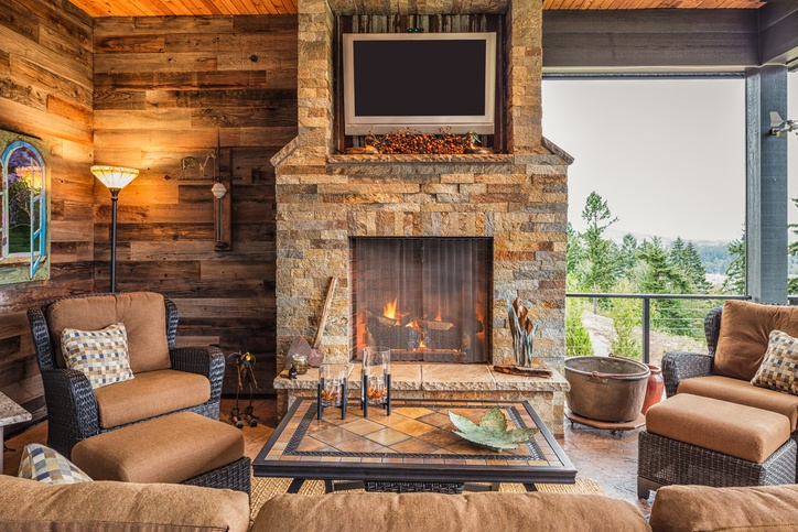 patio with a fireplace and tv hanging above the fireplace
