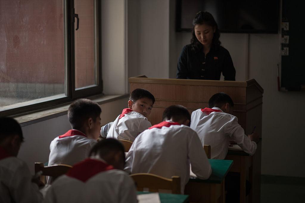 students at desks in a pyongyang school