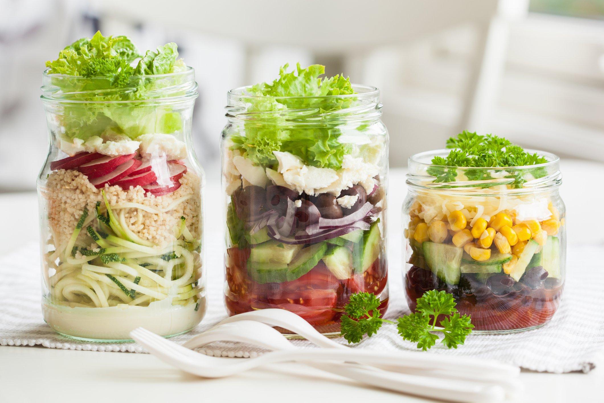 salad in three mason jars