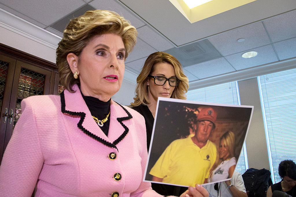 gloria allred holds a photo of jessica drake