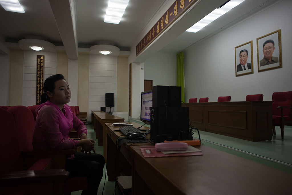 a woman at a computer in north korea